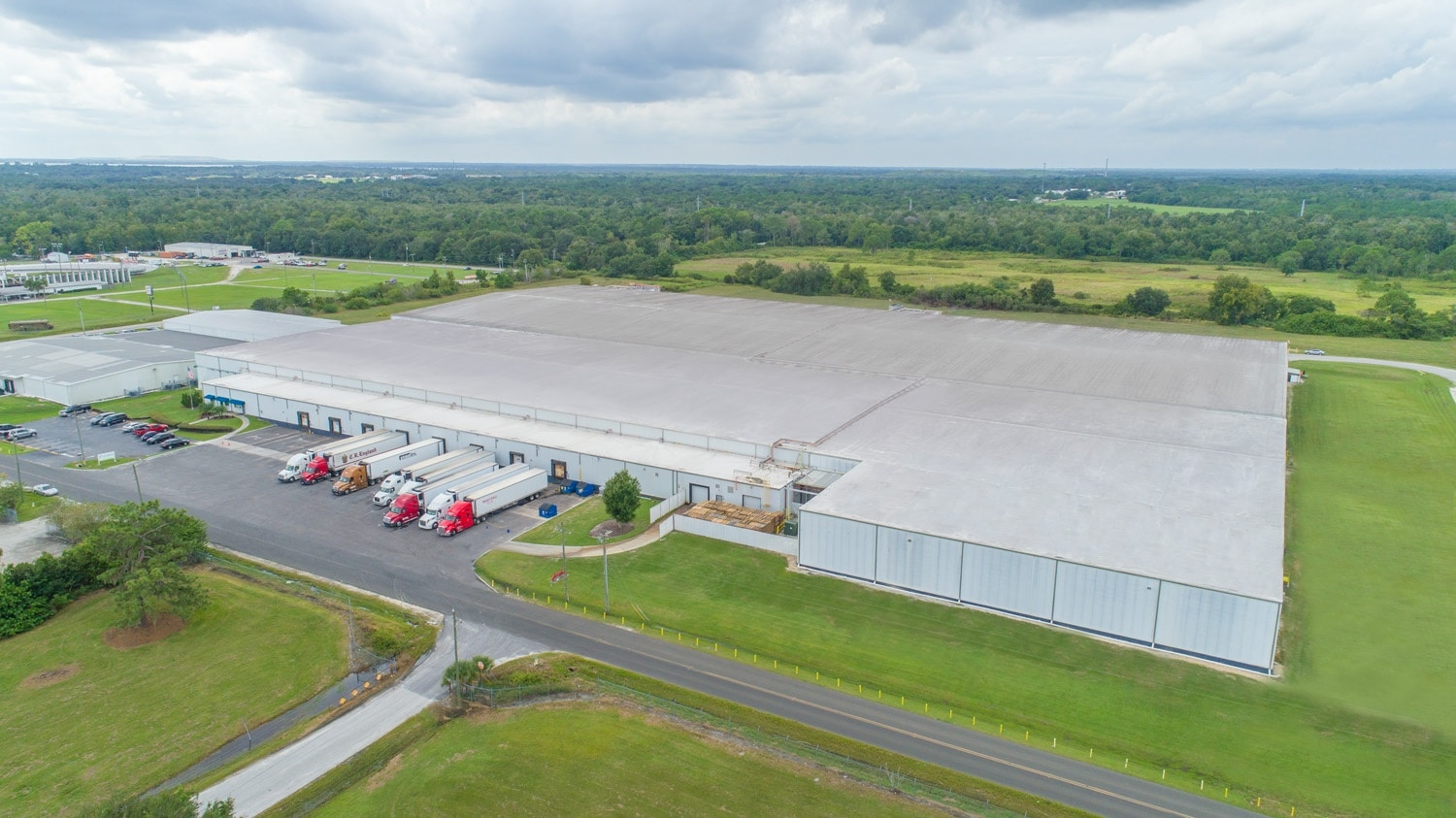 warehouse with trucks drone footage